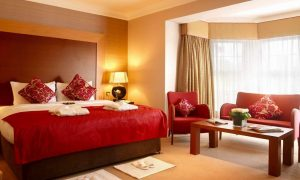 Create your elegant and romantic bedroom with red color scheme