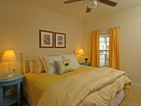 bedroom decorating ideas and designs Remodels Photos Lemongrass Interiors Port St Joe Florida United States beach-style-bedroom